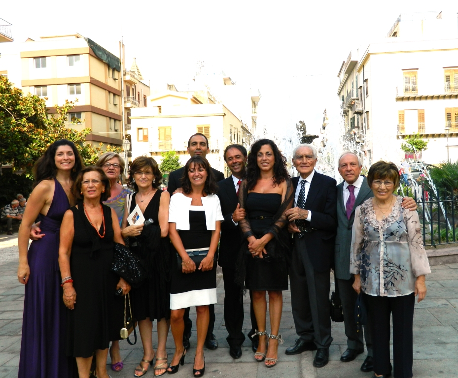 This is a photo of Allison (on the far left) with many of her cousins in Bagheria, Sicily at her cousin Evelina's (The Younger… As with many Italian families there are two cousins Evelina!) wedding in 2011.