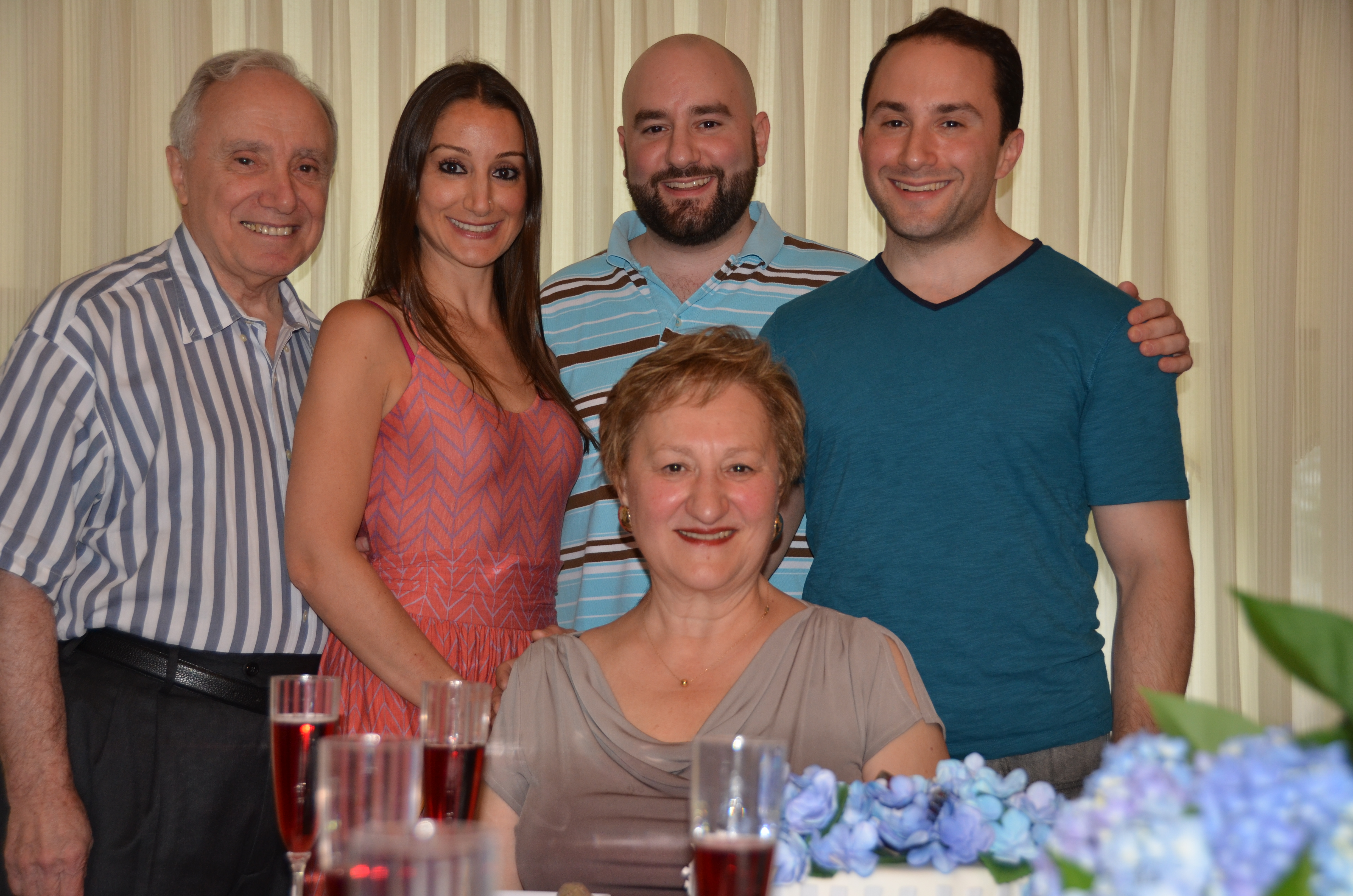 Eleanor and her family at her most recent birthday: seated, Eleanor; standing, L to R: her husband Pat, daughter Alison, son Gavin, son Austin.
