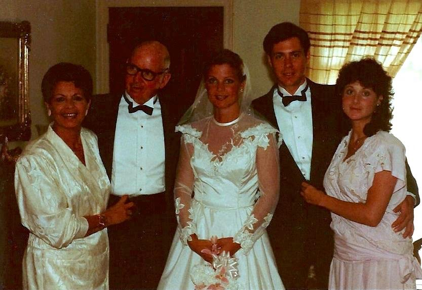 "Rita and TIm on their wedding day in 1987. L to R: Rita's Mom, Dad, Rita, Rita's brother and sister. Rita says, ""My mom always said my brother and sister have il look italiano but I have the 'cuore italiano.' My late uncle Homer Dale Morgan took the photo."""